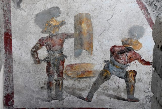 Affresco gladiatori combattenti pompei