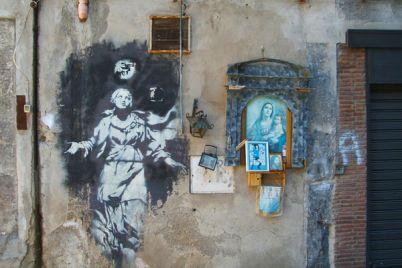 Street-Art-a-Napoli-l'unica-opera-italiana-di-Banksy.-Scoprire-Napoli.jpg