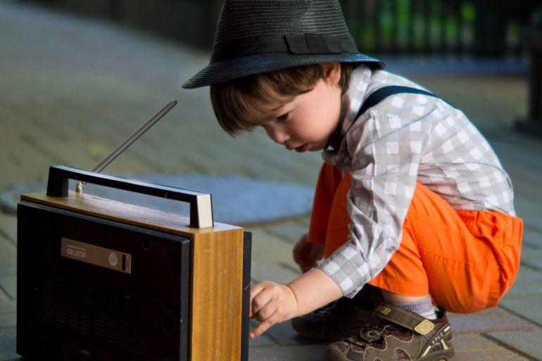 boy-tuning-transistor-radio-1619779-e1585520863304.jpg